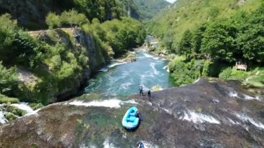 Rafting at waterfall with fresh water