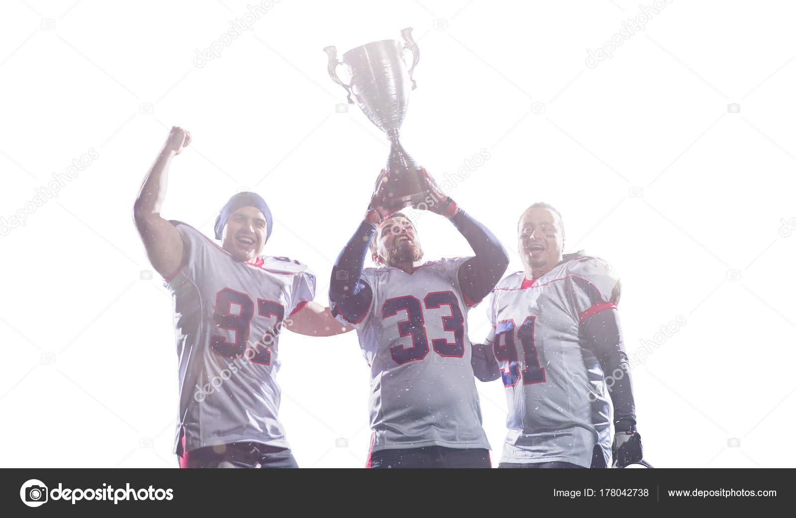 Time De Futebol Americano Com Troféu Celebrando A Vitória
