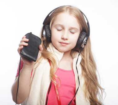 cute happy little girl with headphones