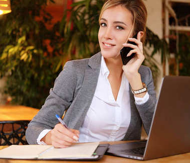 Happy  woman using chatting with mobile and use laptop computer