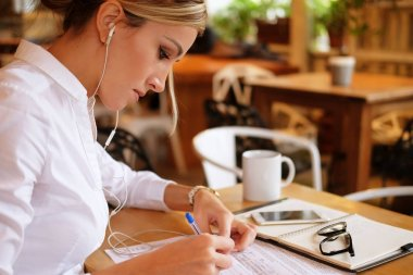 Talented female student  creating article for homework using tex