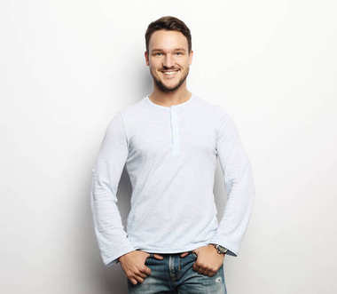 happy smiling man looking at camera on white background