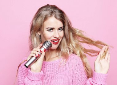 lifestyle and people concept: Beauty model girl singer with a mi