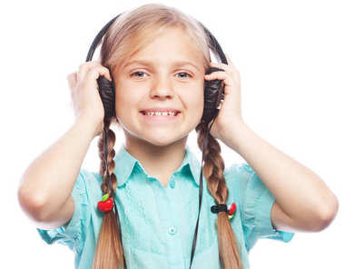 technology, people  and music concept - little girl with headpho