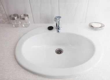 Bathroom interior with white sink