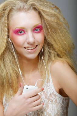 young woman dancing to music on her headphones