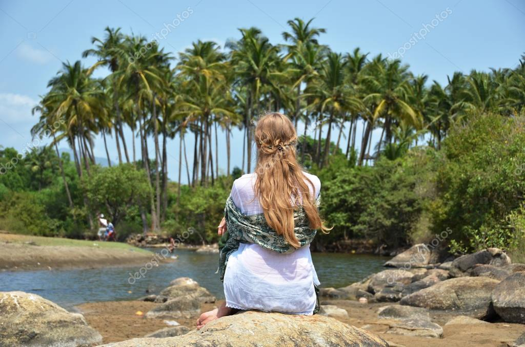 Blond girl relaxing on Agonda beach of South Goa