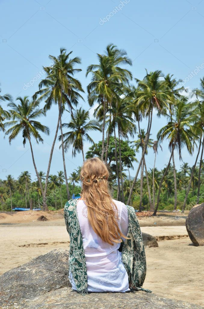 Blond girl relaxing on Agonda beach of South Goa