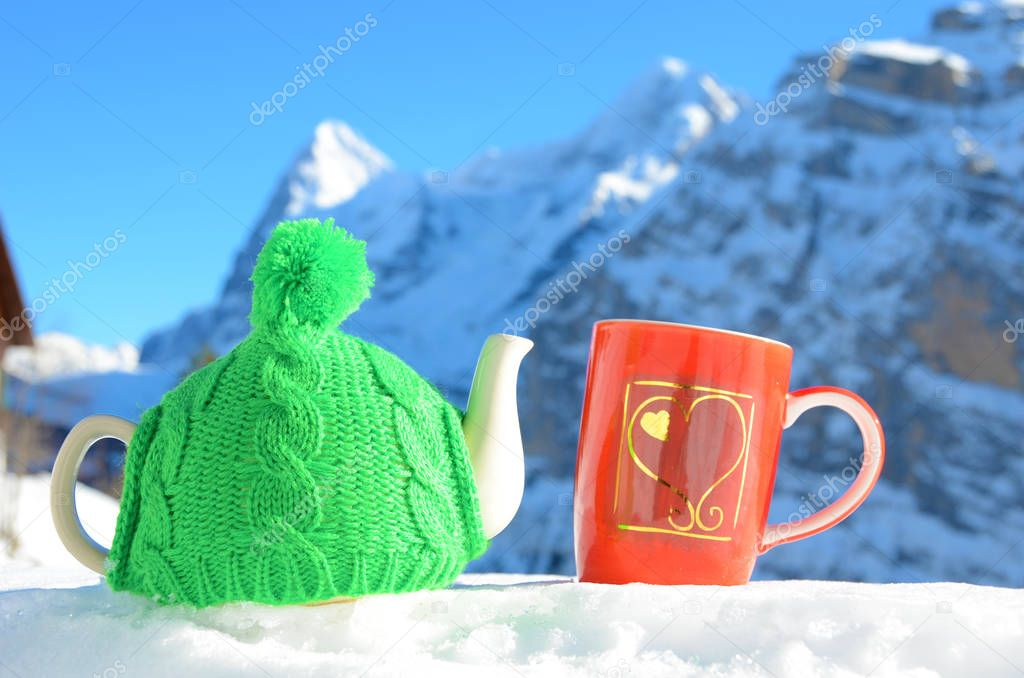 Tea pot and red cup