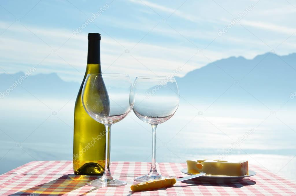 Wine and cheese against Geneva lake