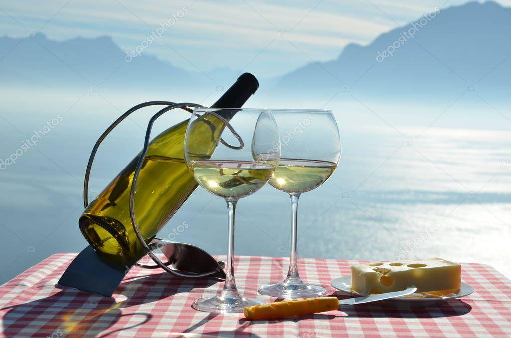 Wine in glasses against Geneva lake