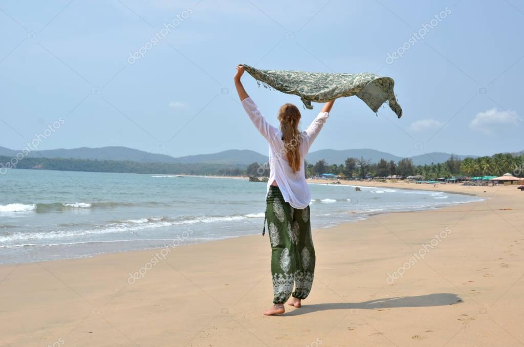 young woman relaxing on Agonda beach