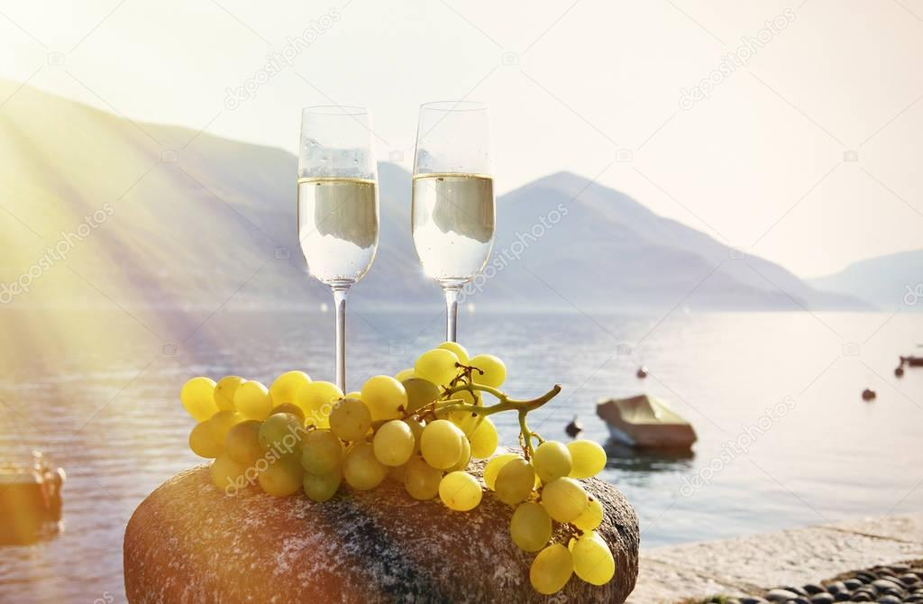 champagne glasses and grapes