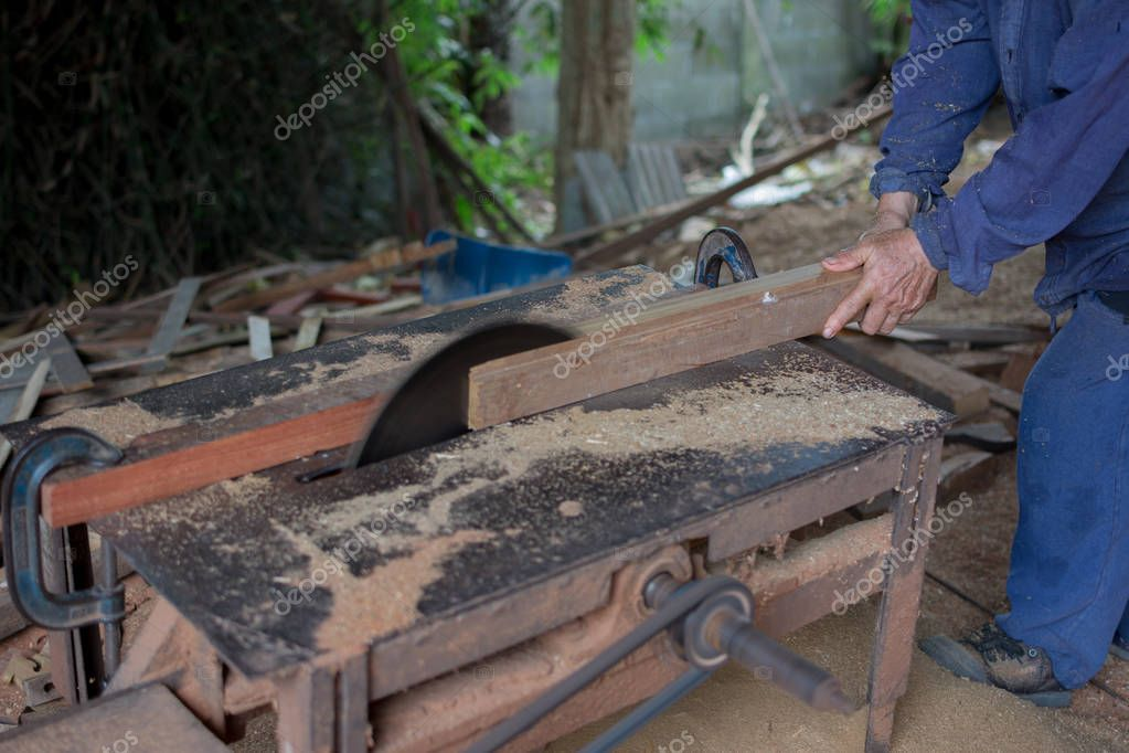 Carpenter tools on wooden table with sawdust. Circular Saw. Carp