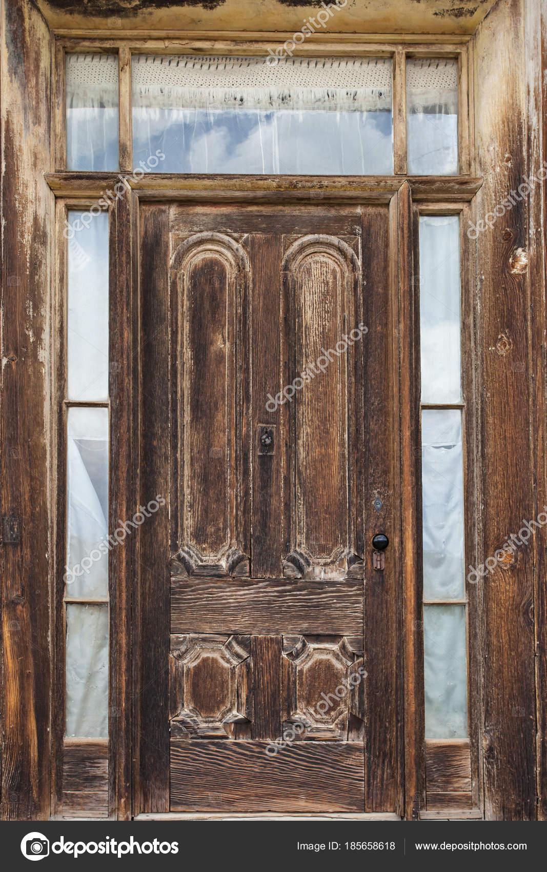 Old Wooden Door in Ghost Town u2014 Stock Photo & Old Wooden Door in Ghost Town u2014 Stock Photo © paulbradyphoto #185658618