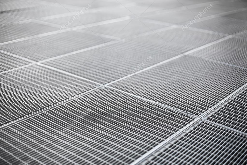 grille de ventilation m talliques sur un trottoir photo. Black Bedroom Furniture Sets. Home Design Ideas