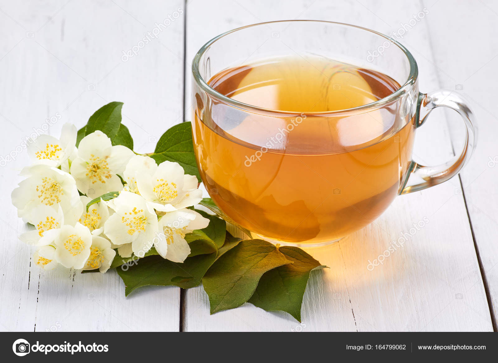 Jasmine Tea And Jasmine Flowers On A White Wooden Table Stock