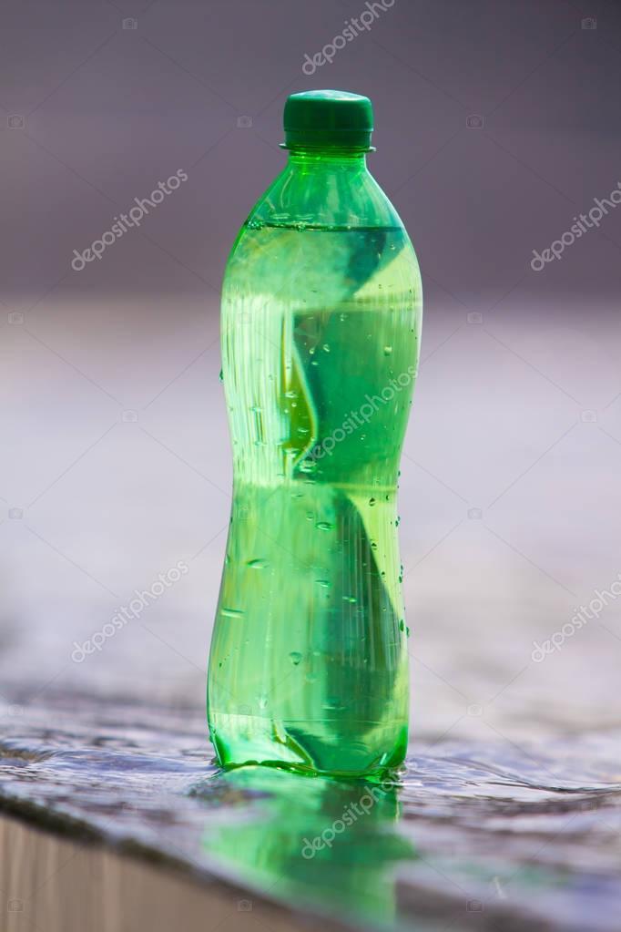 water in the green bottle