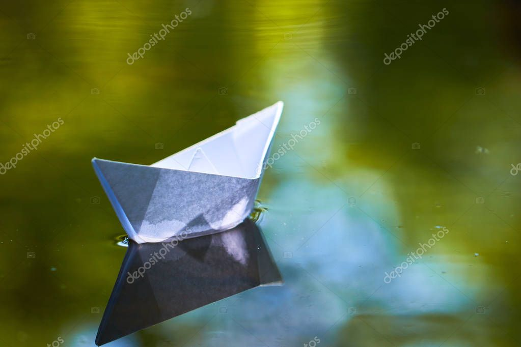 paper boat on water surface