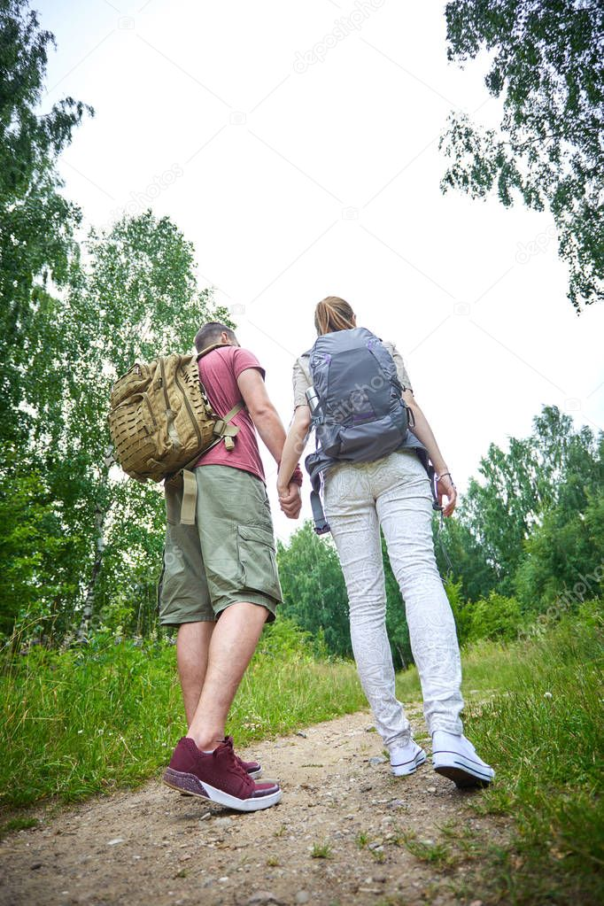 two travelers in summer meadow at sunny day