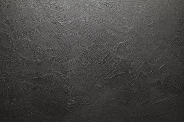 Uneven surface of plastered wall - black background or texture