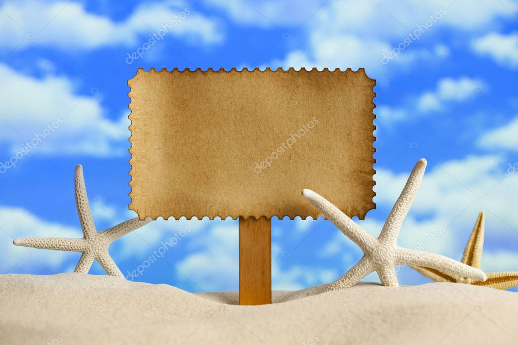 Summer background - blank paper sheet and starfish on beach
