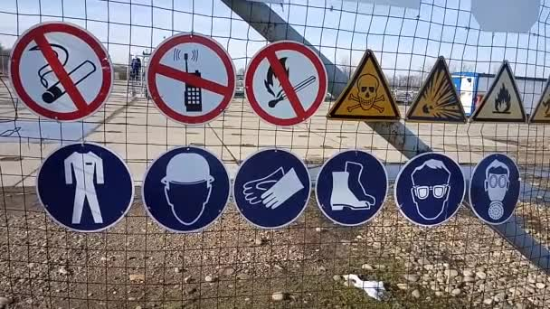 Warning and prohibition signs on a gas well fence