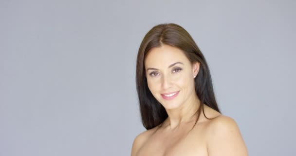 Cute single bare shouldered young adult woman