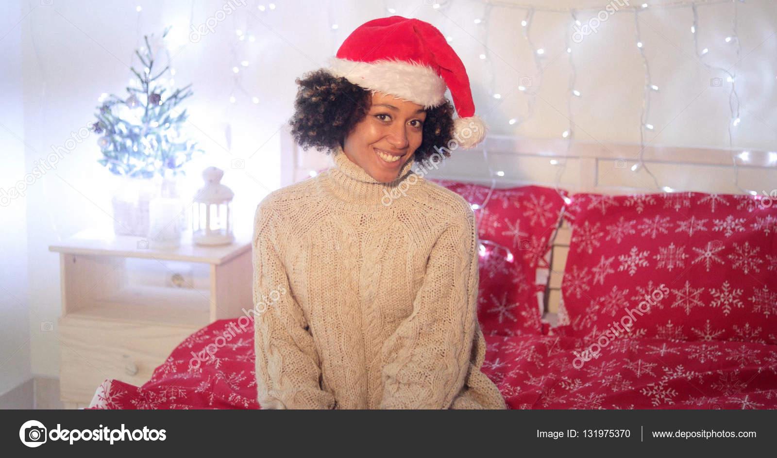 fae462717b242 Pretty young woman wearing a red Santa hat — Stock Photo © dashek ...