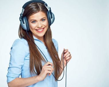 Happy young woman listening music with headphones.