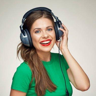 Beautiful girl listening music. smiling woman