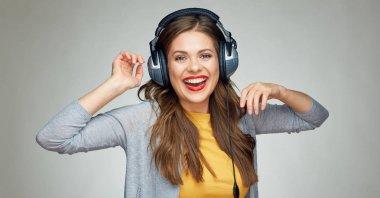 Dancing young woman listening music