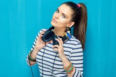 Woman with headphones on neck