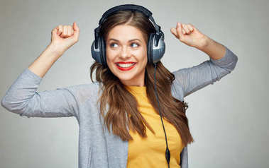 Woman listening to music on big headphones
