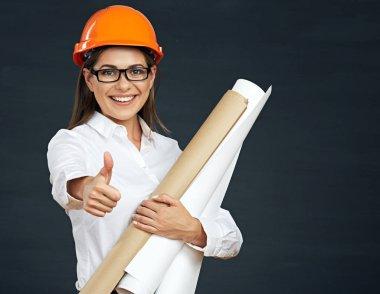 woman architect holding blueprints