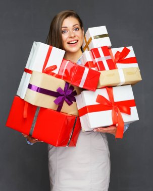 business woman holding pile, stack, heap of presents