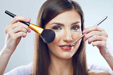 young beautiful woman with make up brush