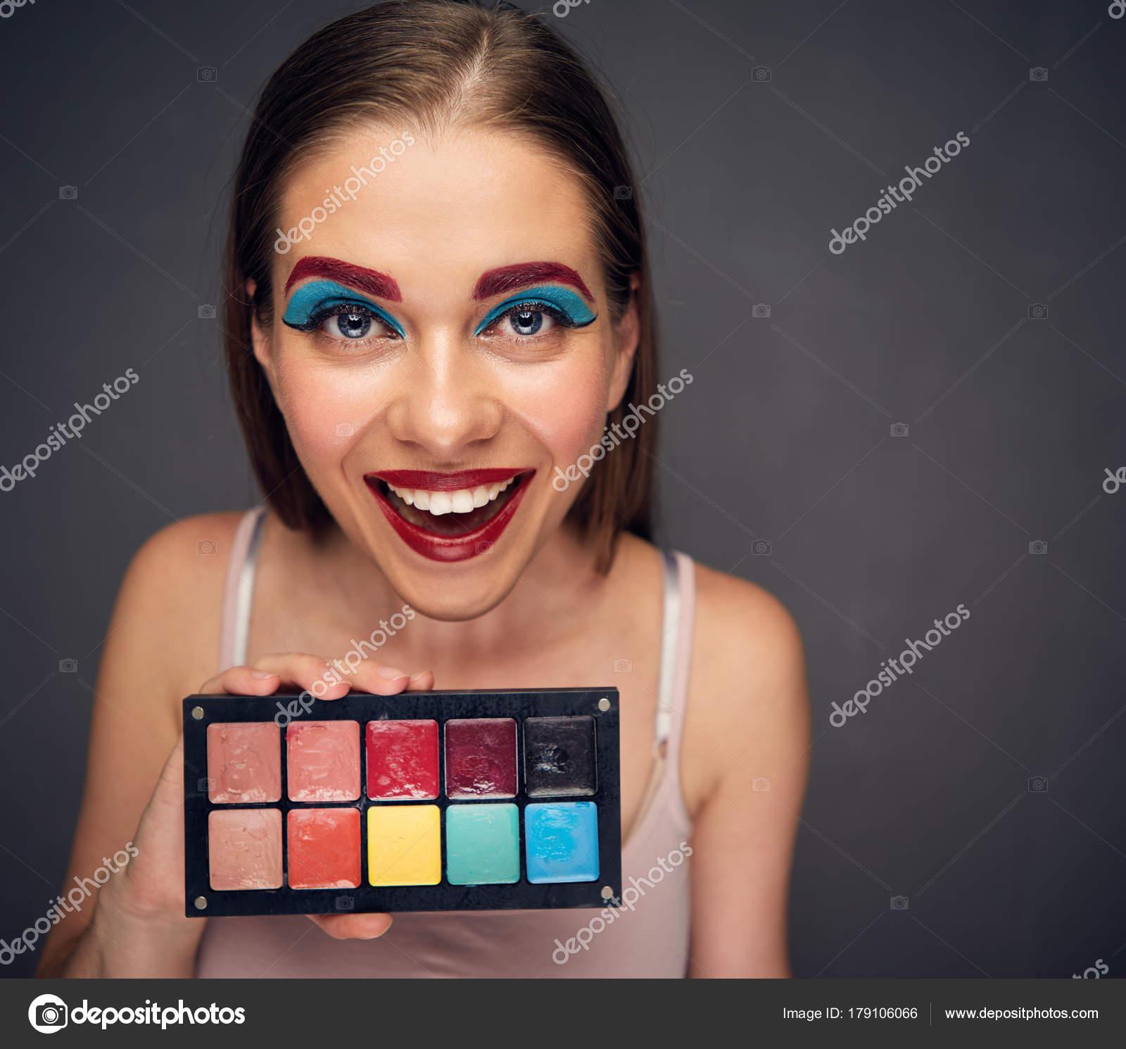 crazy makeup artist clown worst makeup holding palette lipstick