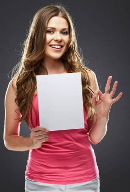 woman holding white blank board and showing OK symbol