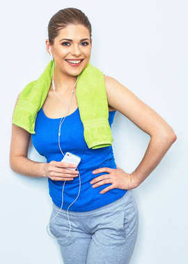 Woman listening music. After sport exercise.