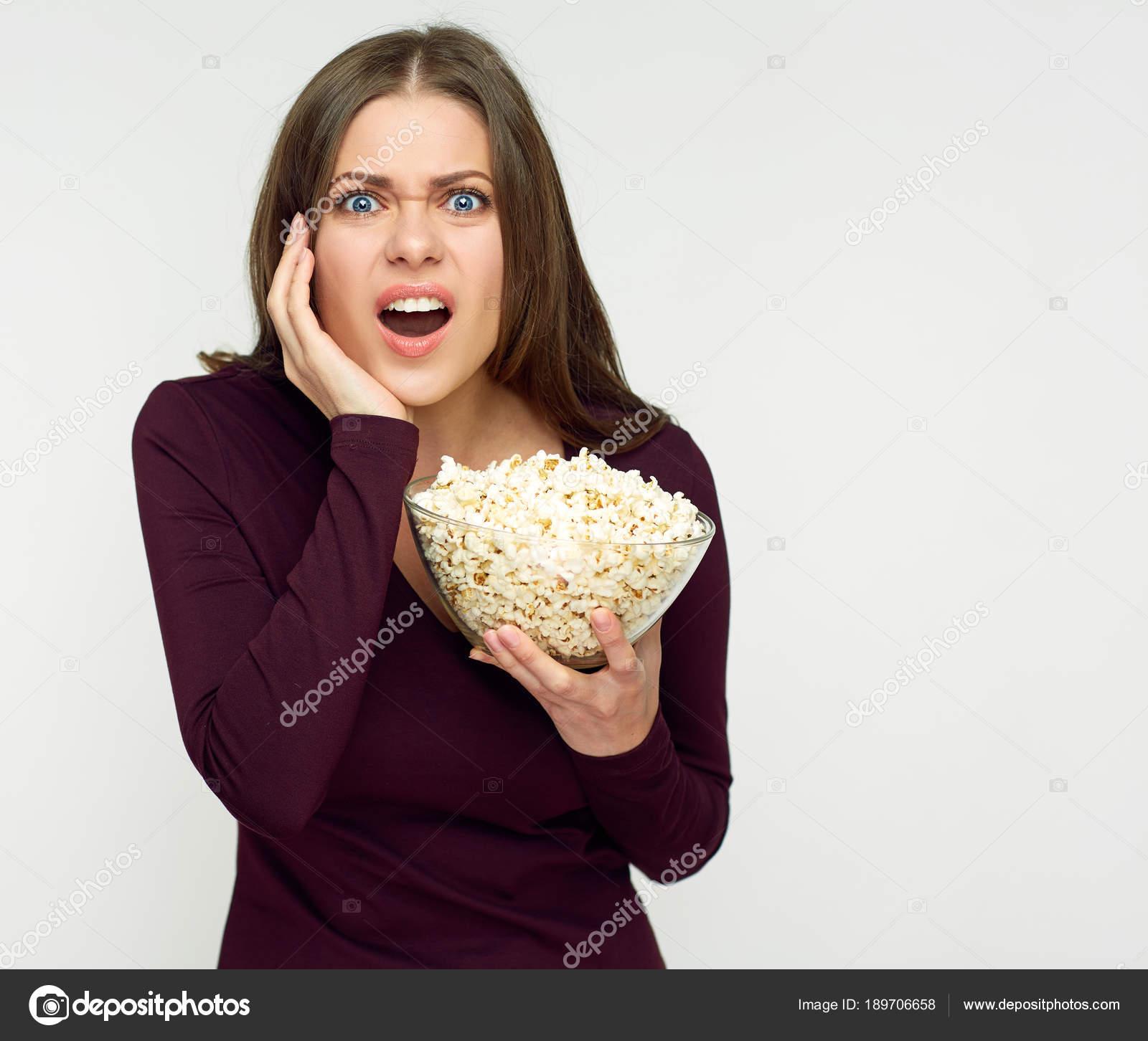 surprising woman long hair holding glass bowl popcorn stock photo