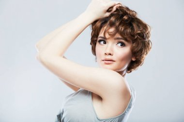 portrait of sexy young model with short curly hair