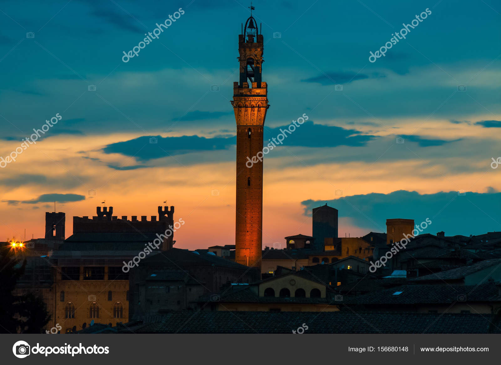 Torre del Mangia in Siena against sunset sky. Tuscany, Italy.