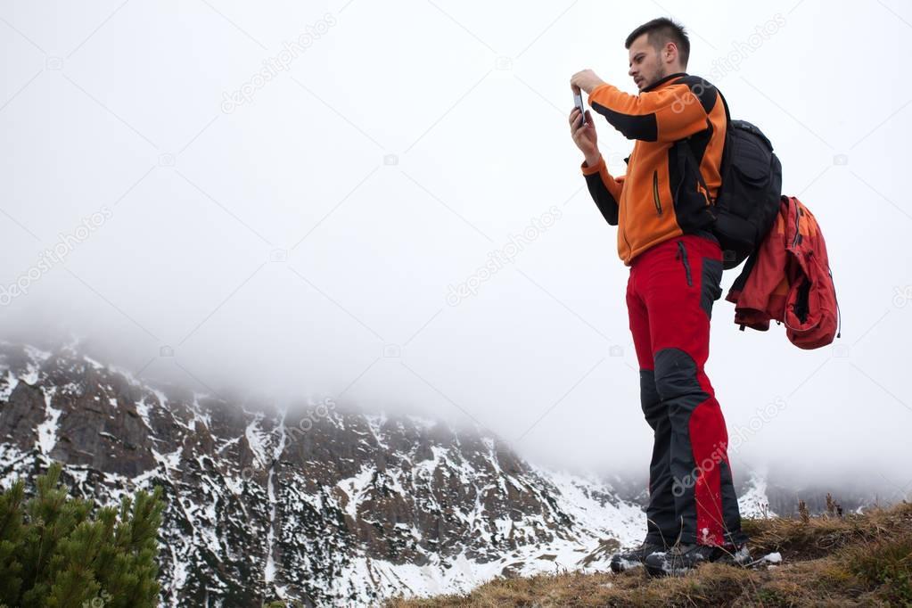 Man taking a photo on mountains