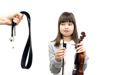 Parents force the child to play the violin.