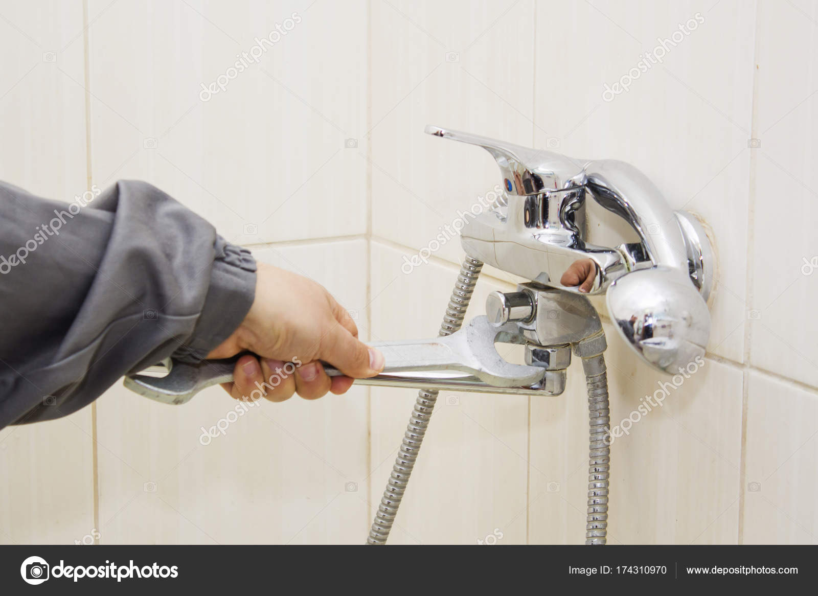 Plumber hands fixing water tap with spanner — Stock Photo © mihail39 ...