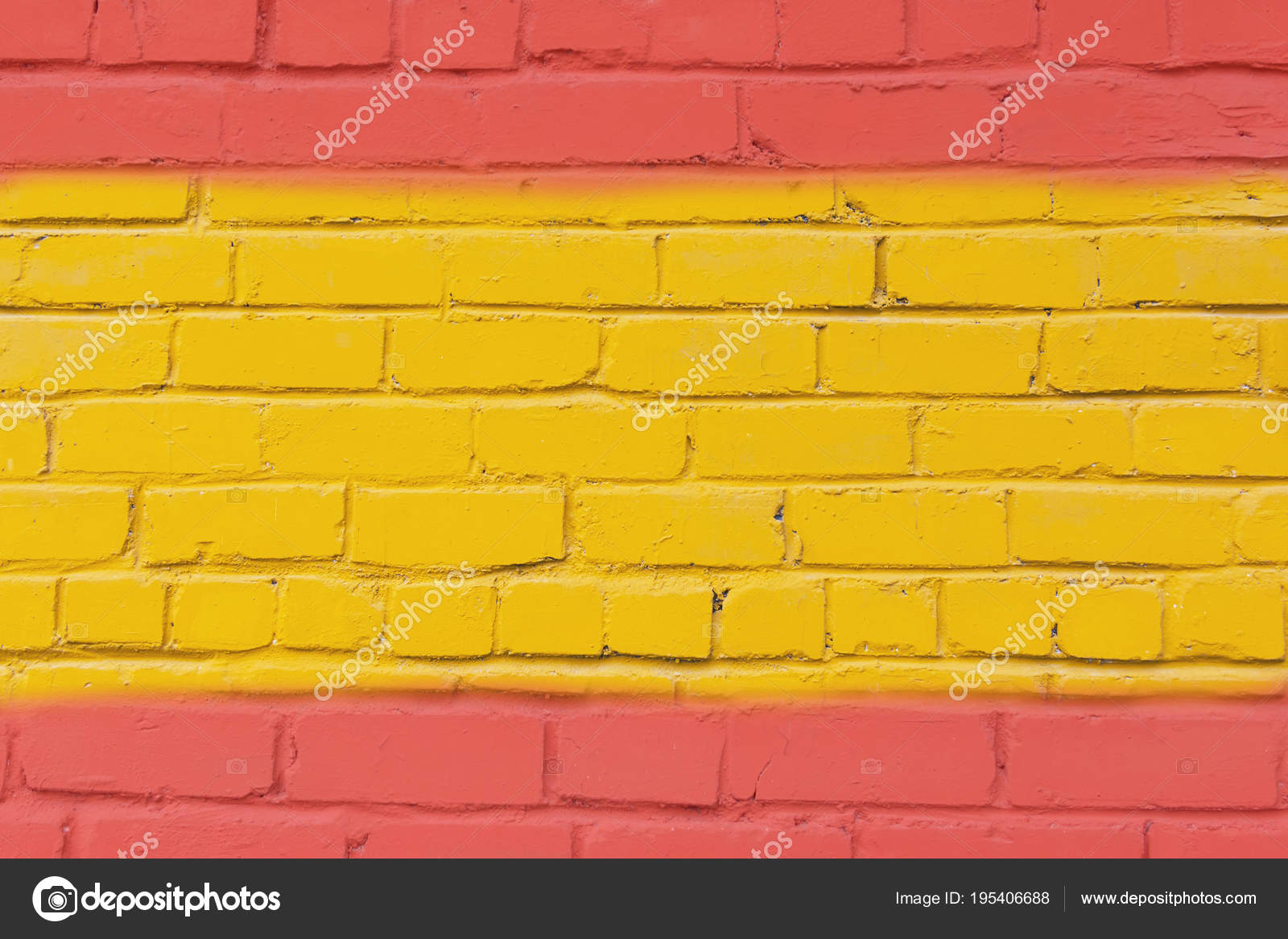 Painted brick wall in the colors of the flag of Spain. — Stock Photo ...