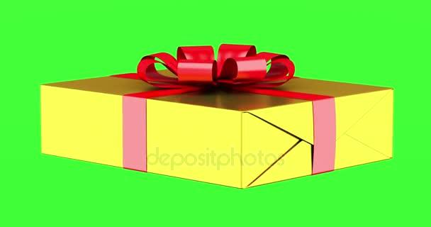 Dárková krabice s červenou stužkou a luk smyčky otočit na pozadí zelených chromakey