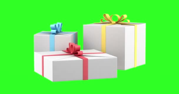 Dárkové krabičky s barevné stuhy a mašle smyčka otočit na pozadí zelených chromakey