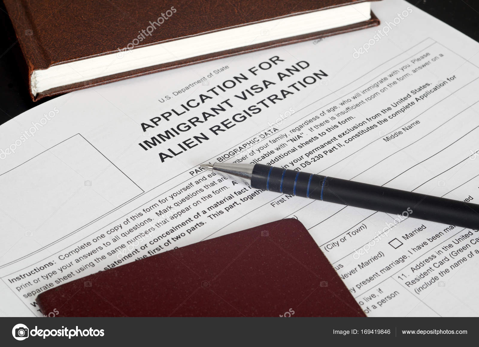 Paper Form US immigration visa lies on the black surface